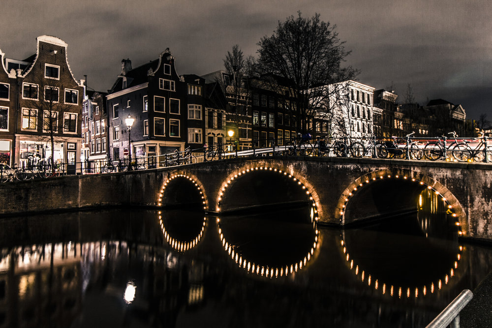The canals of Amsterdam at night. Image credit:  Myk Jordan / Creative Commons