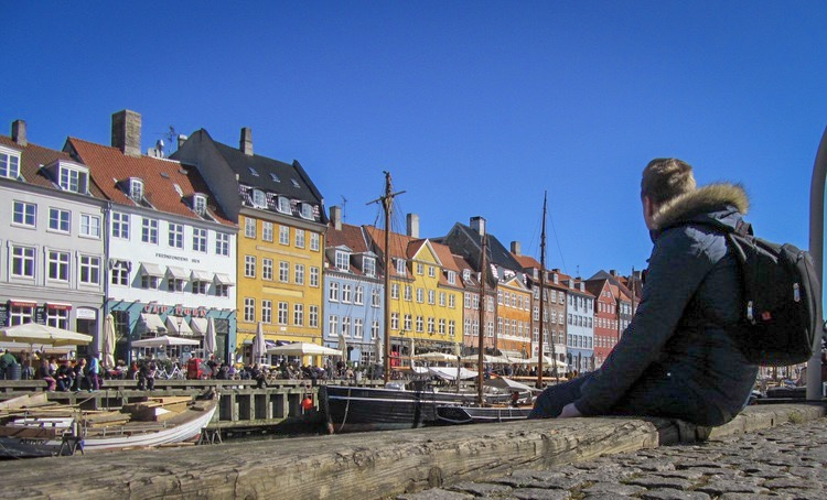 Looking at the beautiful, multicoloured houses at Nyhavn, Copenhagen.