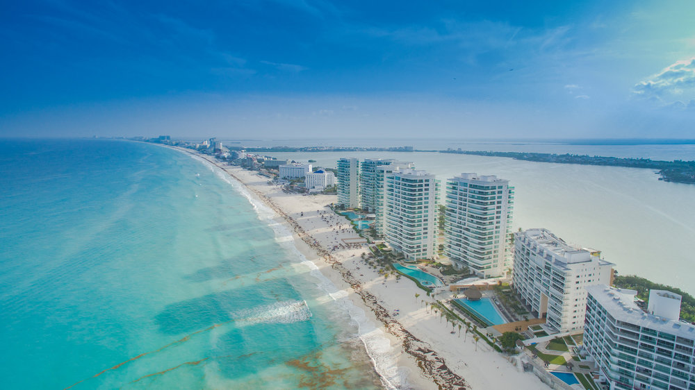 Head to Cancun for golden sands and stunning blue waters. Image credit:  dronepicr / Creative Commons