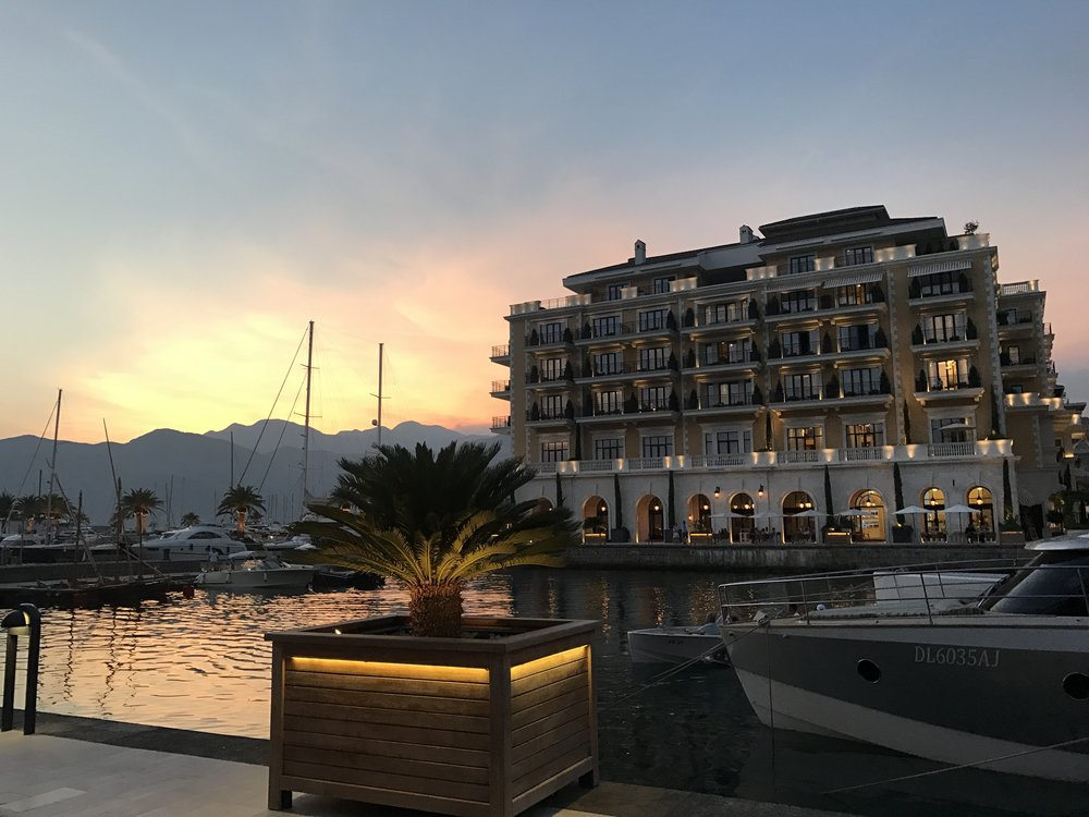 The sun sets behind the luxurious Regent Porto Montenegro hotel.