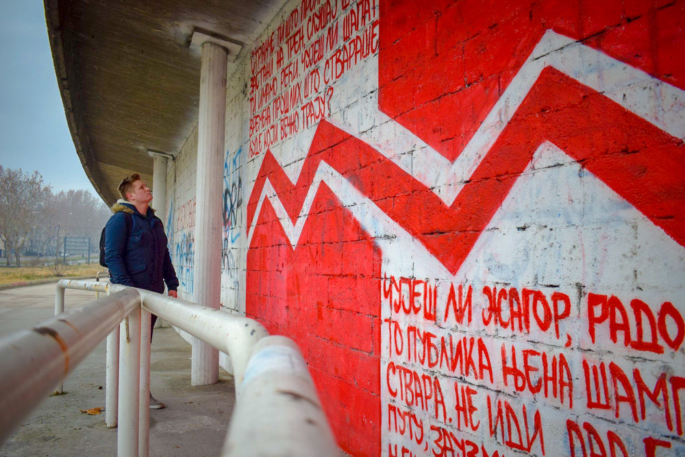 Admiring graffiti on the walls of Rajko Mitić Stadium, the home of Red Star Belgrade.