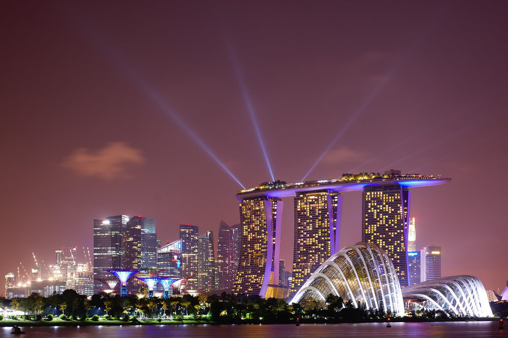Singapore's skyline comes to life at night. Image credit:    Nicolas Lannuzel   /   Creative Commons