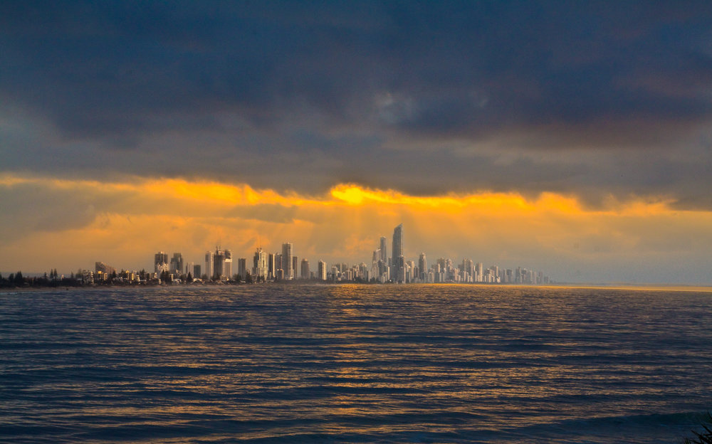 Gold Coast's skyline dancing under the glow of an Australian sunrise. Image credit:    Michael Dawes   /   Creative Commons