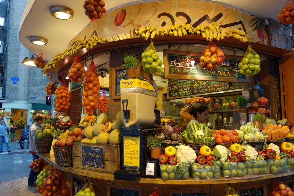 A stall selling fruit and vegetables in Tel Aviv. Image credit:    Evgenii   /   Creative Commons