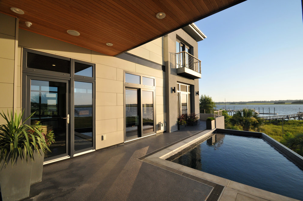 - April 10, 2017Completed in 2015, the Woodard residence is a new construction house on the Ashley River in Charleston that features a pool with views of the river and shoreline on the other side, a home office, an open floor plan, and a covered deck for outdoor entertaining.