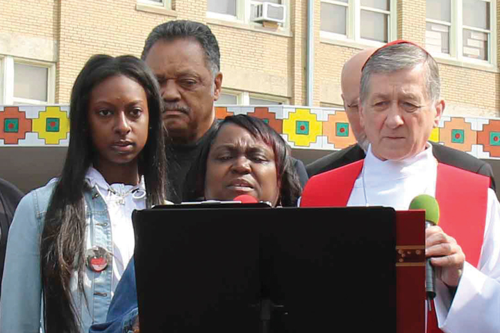 Domonique Jones pictured Left here with Jessie Jackson, Ruby Taylor from Taproots Foundation, and Cardinal Blase Cupich at a march for peace in Englewood in April of 2017.