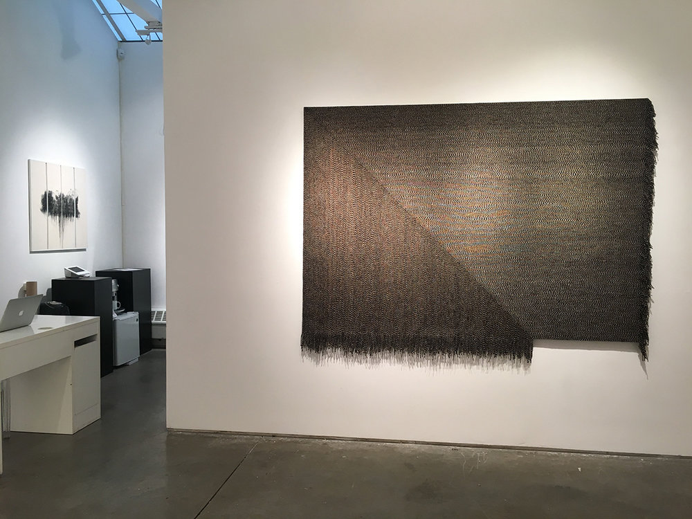 "(L-R) Giulia Dall'Olio, g 19 83 d, 2015 Oil on engraved panel, 32"" x 33"" Matthew Larson, Tilt, 2014 Yarn on velcro, 62"" x 83"""