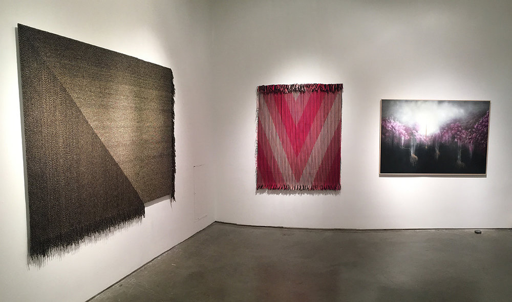 "(L-R) Matthew Larson, Tilt, 2014 Yarn on velcro, 62"" x 83"" Matthew Larson, Open, 2015 Yarn on velcro, 60.5"" x 49"" Giulia Dall'Olio, g 8 4 d, 2014 Oil on engraved panel, 43"" x 63.5"""