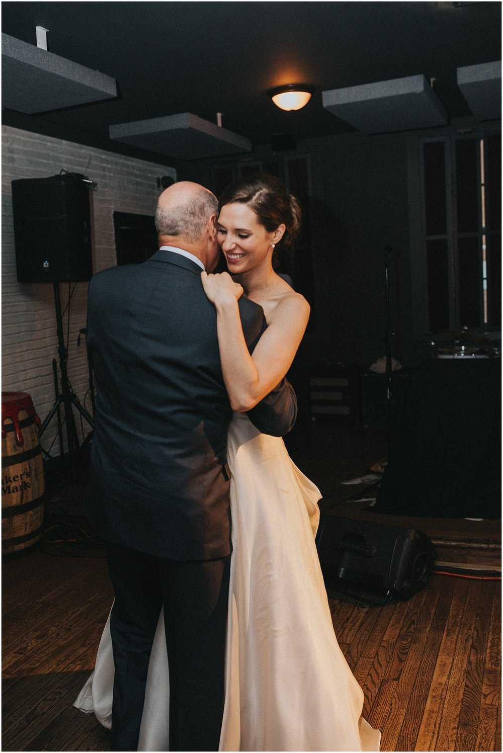 Father Daughter dance at wedding reception in the Twisted Tail Restaurant near Penns Landing in Philadelphia Pennsylvania