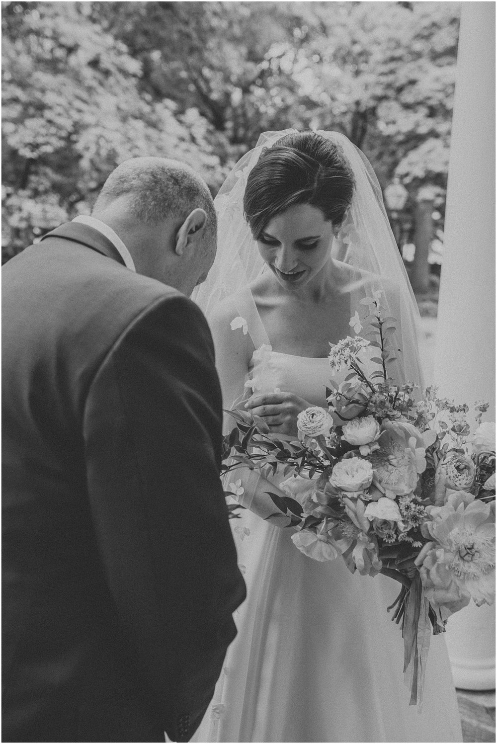 Bride anxiously waiting with her father before wedding ceremony at Arch Street Meeting House in Philadelphia Pennsylvania