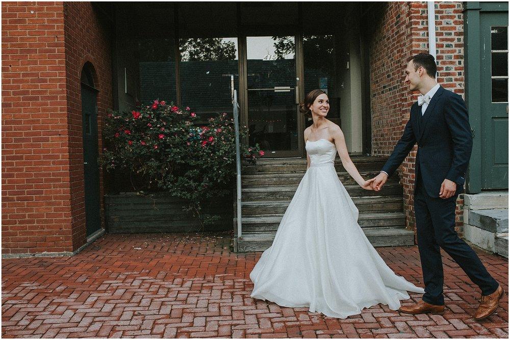 Bride and Groom Portraits strolling around Philadelphia Pennsylvania near Penns Landing