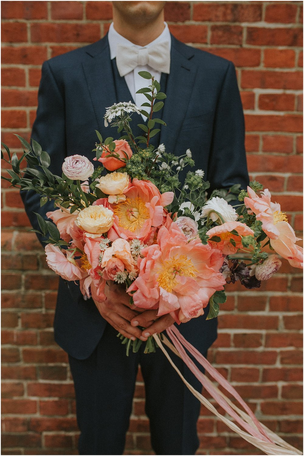 Groom and Bridal bouquet at Arch Street Meeting House in Philadelphia Pennsylvania