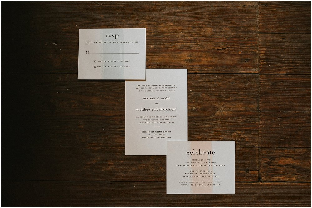 Pastel colored wedding invitations at the Arch Street Meeting House in Philadelphia Pennsylvania