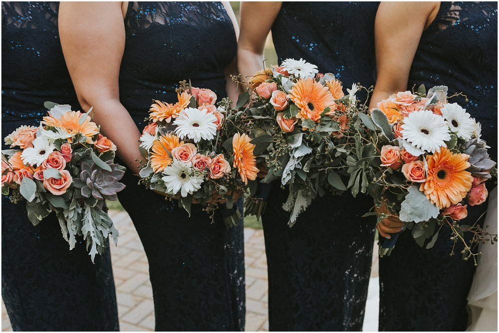 Bridesmaid bouquet photos at Rock Island Lake Club in New Jersey