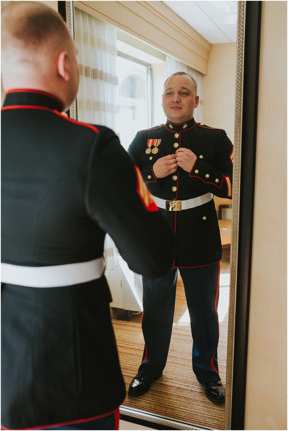 Marine Corp Groom in his dress blues getting ready for his wedding
