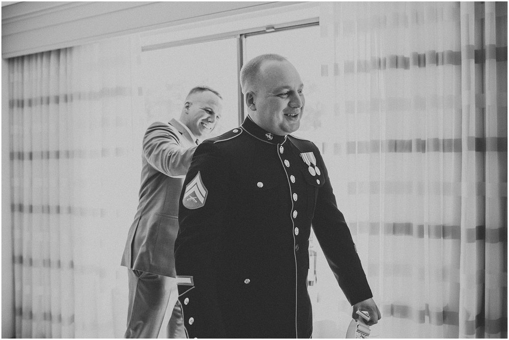 Groom getting ready for his wedding ceremony while wearing his Marine Corp Dress Blues