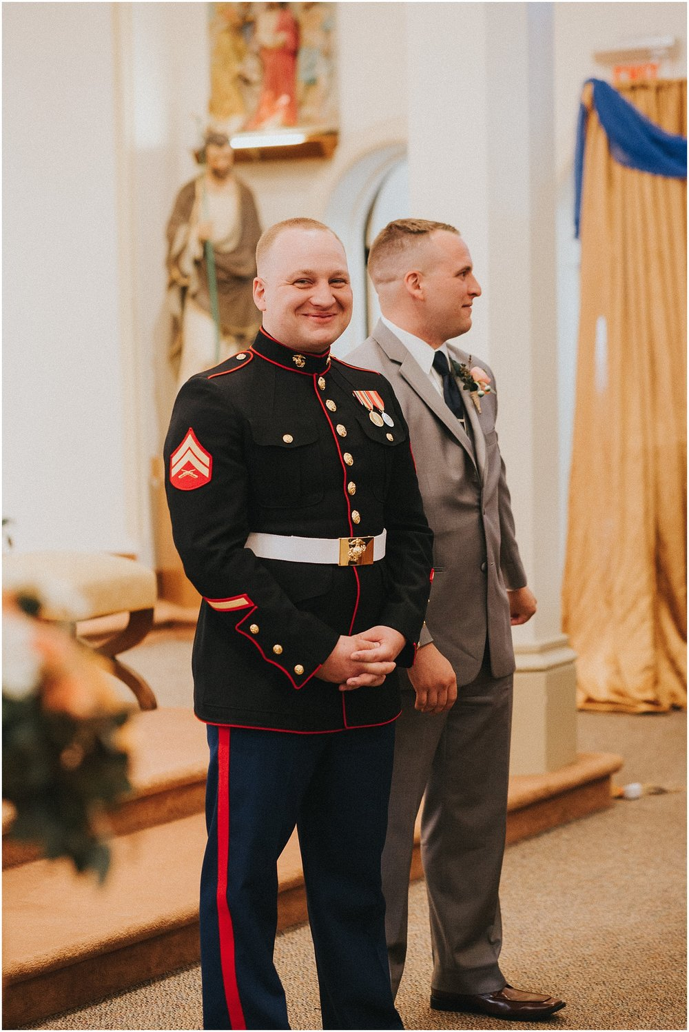 Marine Corp Groom anticipating seeing his Bride during their wedding ceremony