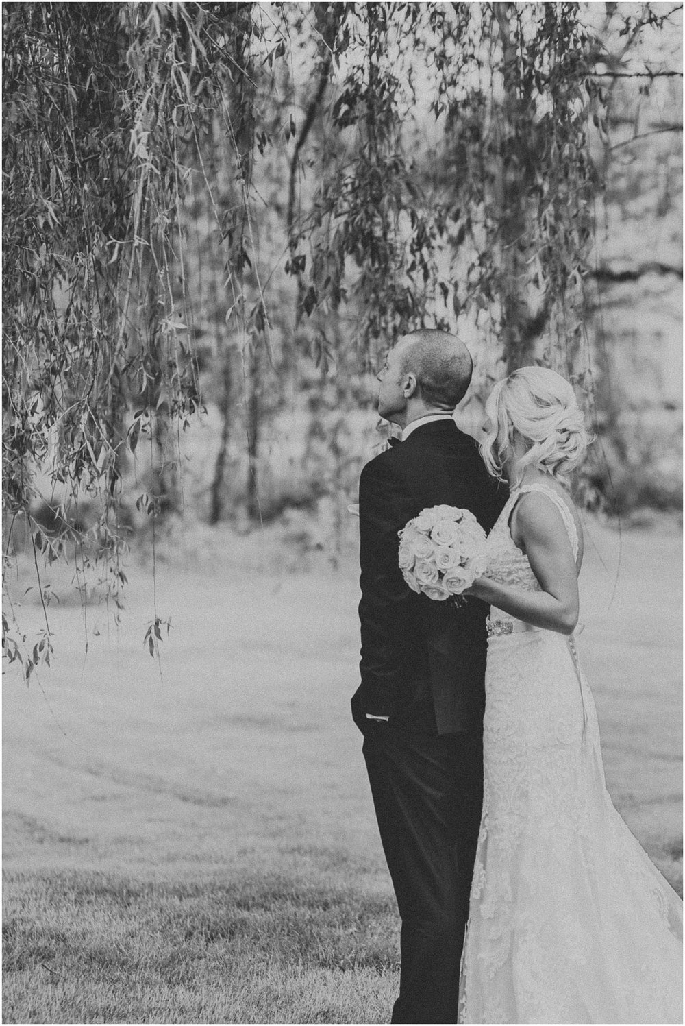 Bride and Groom anticipate first look on their wedding day under willow tree by gorgeous pond at The Historic Acres of Hershey in Hershey Pennsylvania
