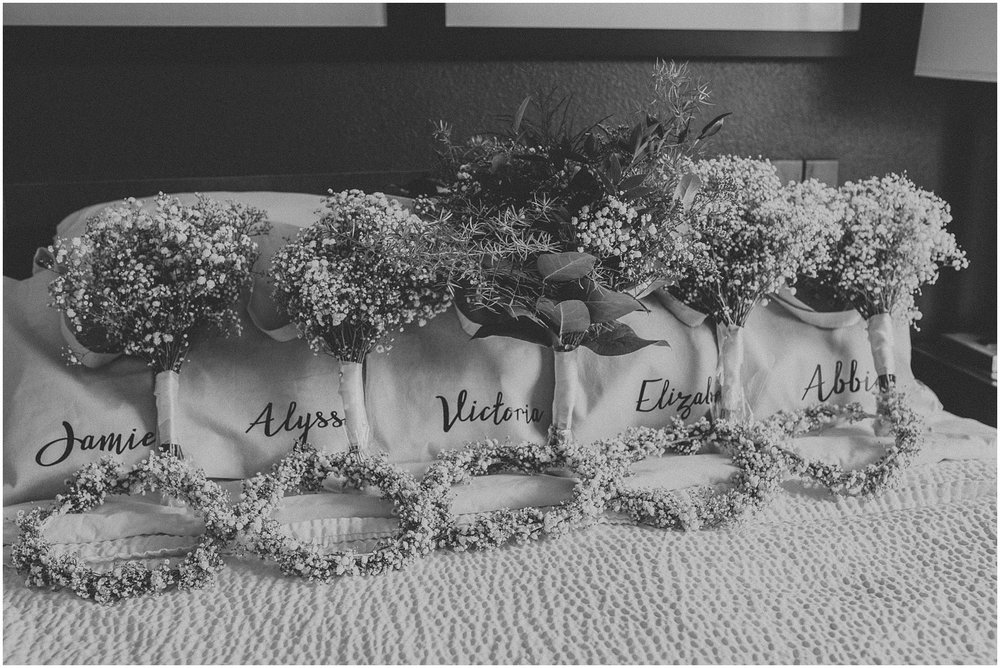 Flower crown and wedding bouquets of baby's breathe with personalized bridesmaid gifts