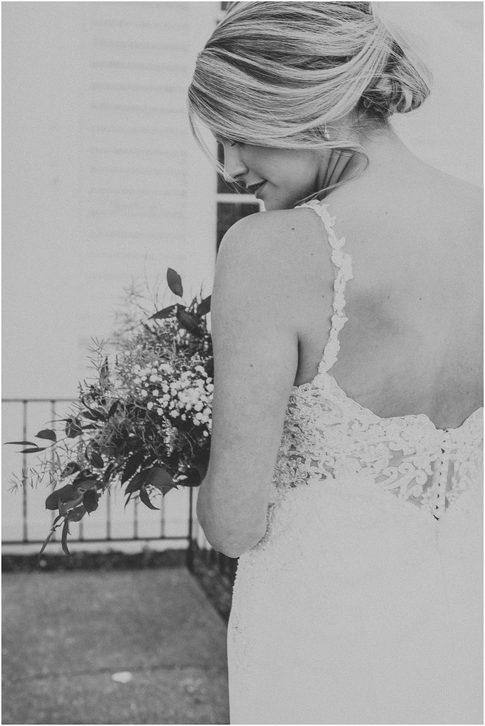 Black and white Bridal portrait as she anticipates walking down the aisle