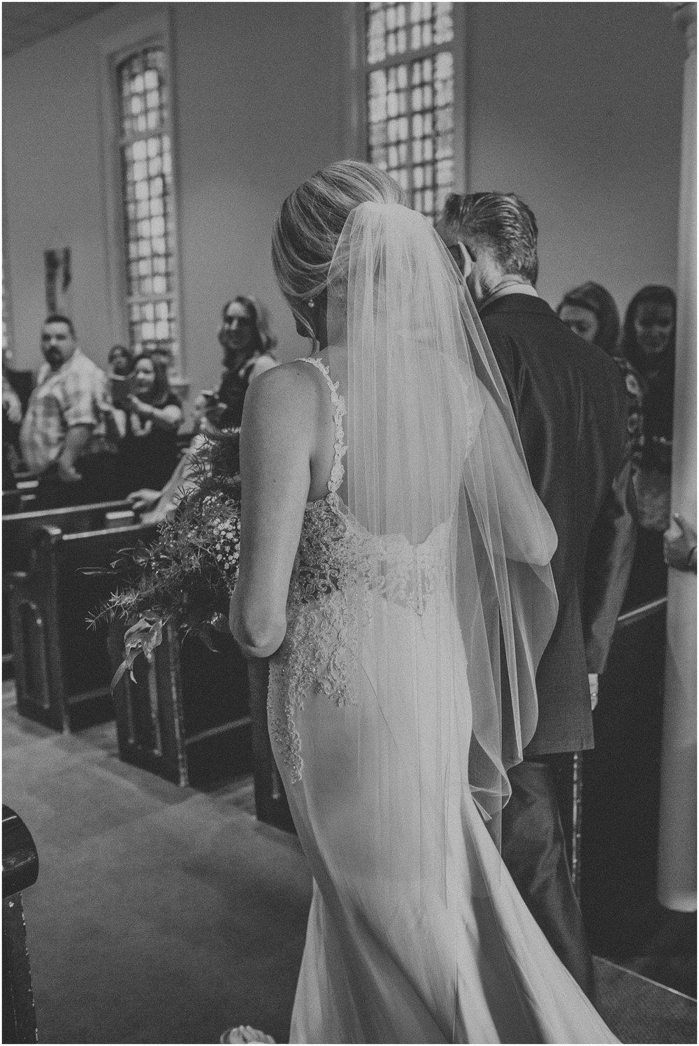 Beautiful bride walking down the aisle towards her groom