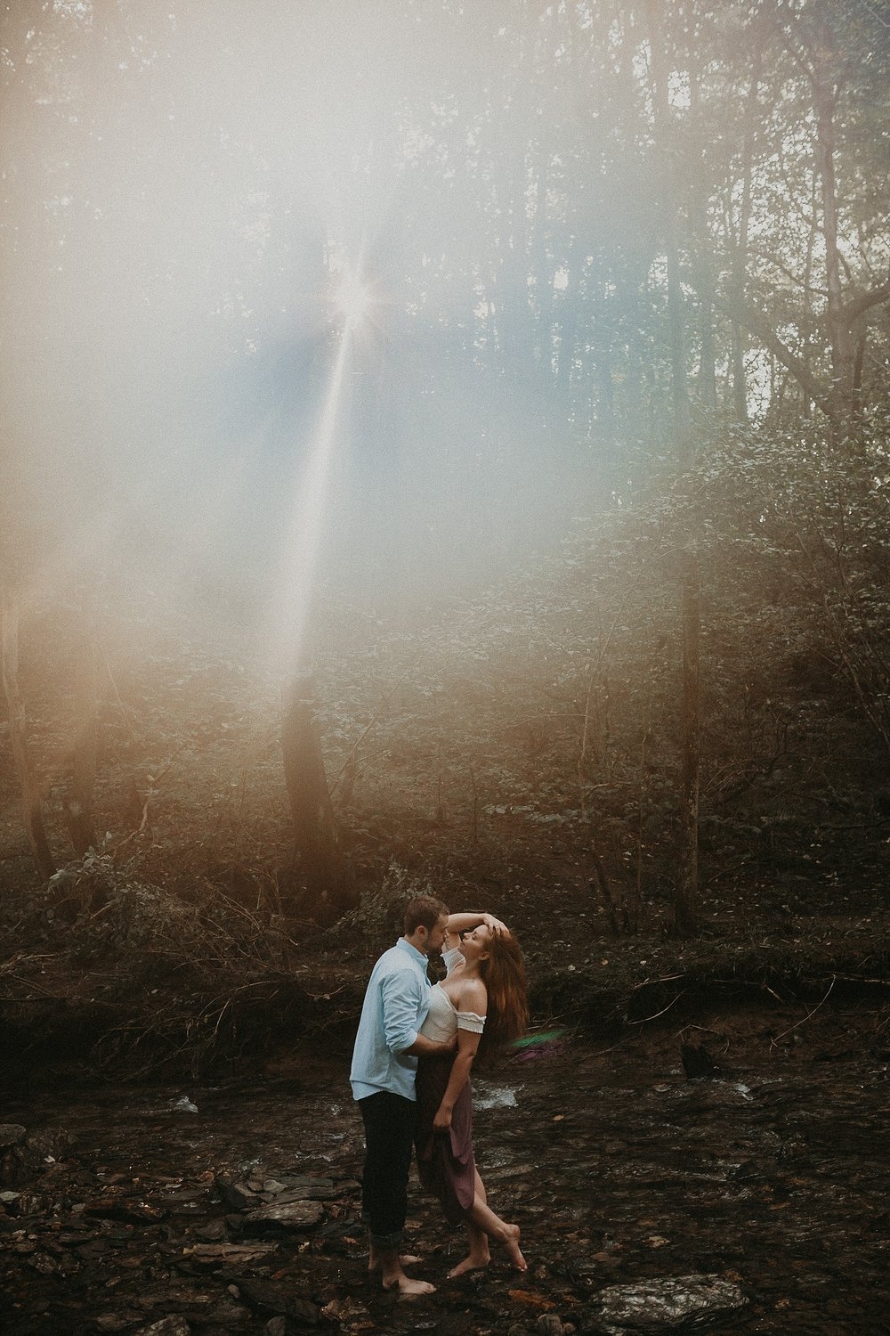 Sunburst in background of couples session