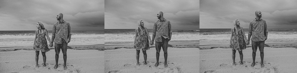 Couple standing beside one another on beach during Stone Harbor beach engagement session
