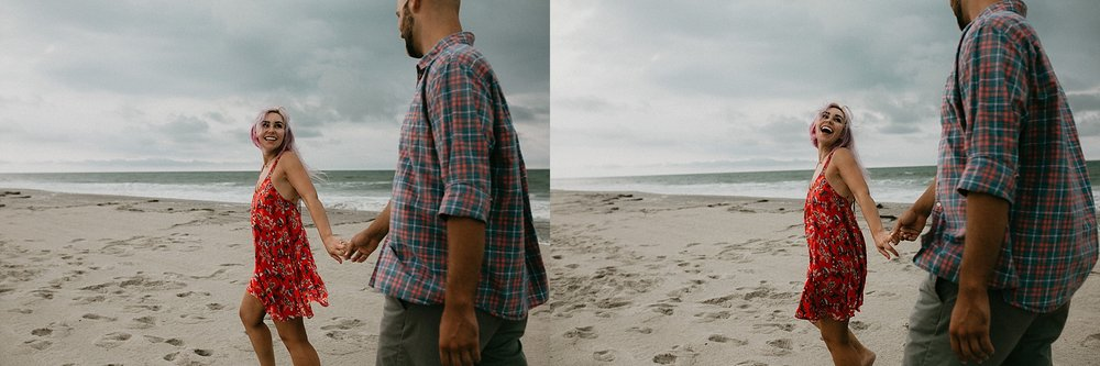 Women looking lovingly at man while holding his hand and taking a walk on Stone Harbor beach