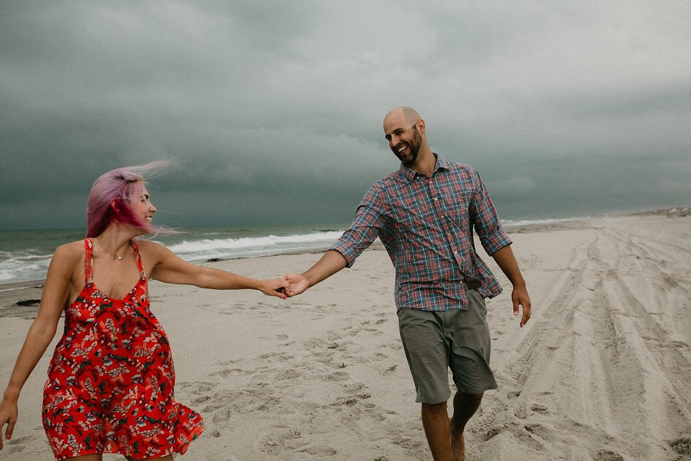 Candid and documentary style engagement photos on Stone Harbor beach