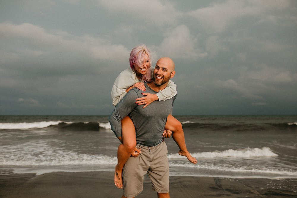 Candid and laughing engagement photos during Stone Harbor beach engagement session