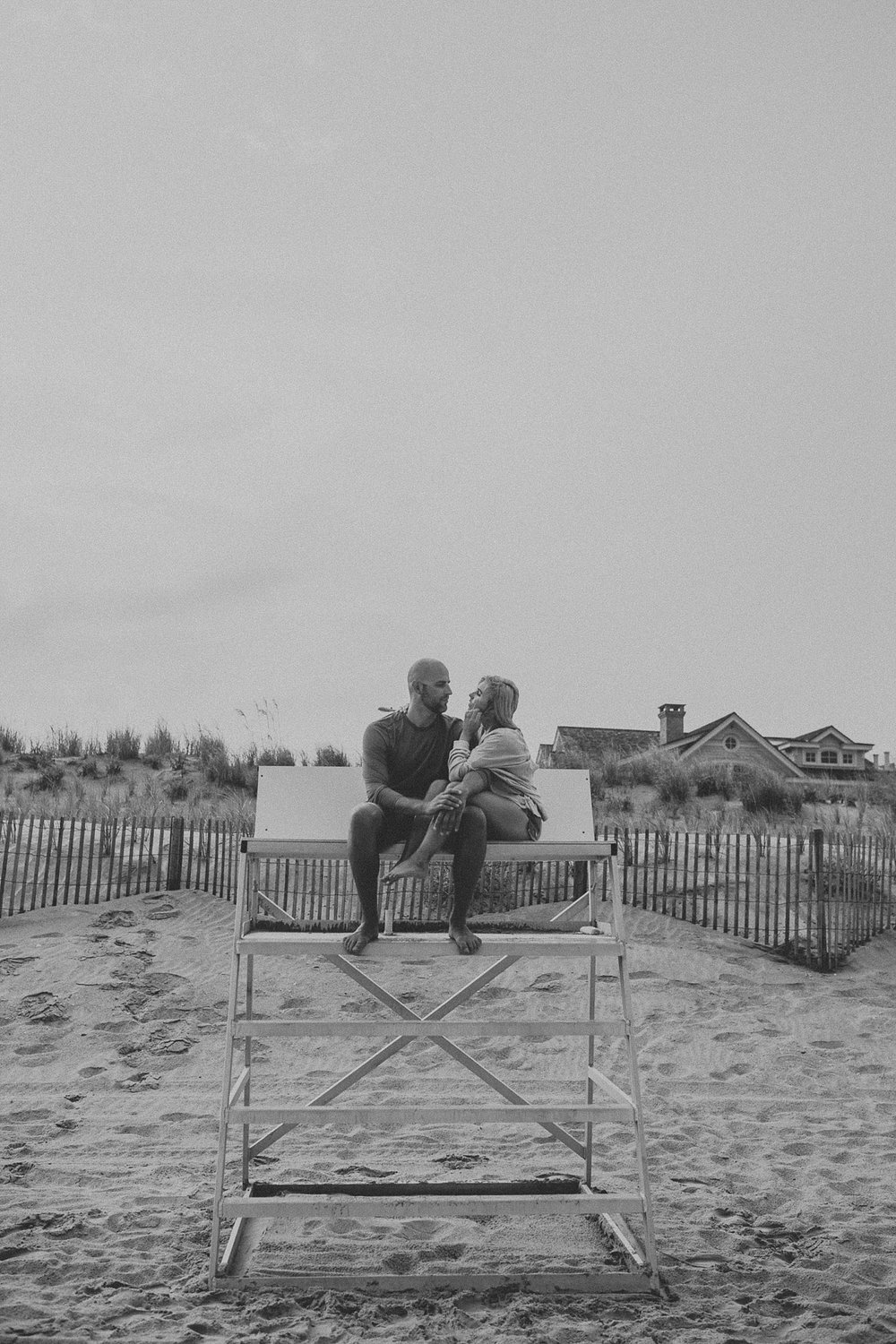 Engagement photos on lifeguard stand in Stone Harbor beach