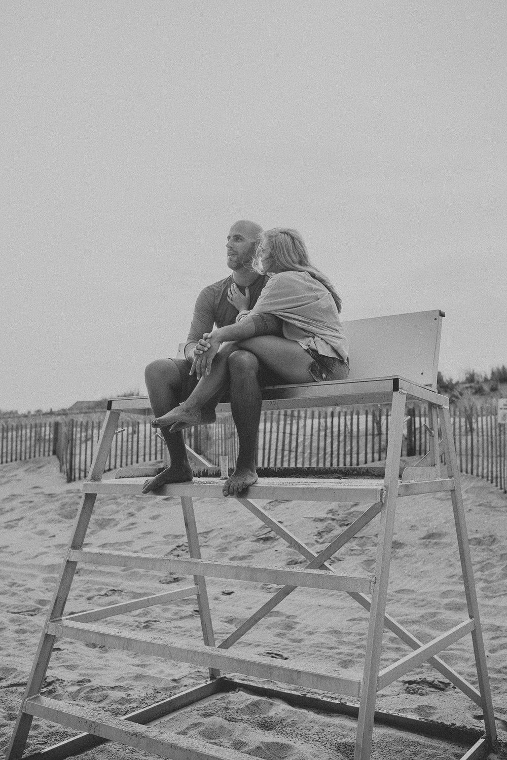 Couple looking out over the ocean on lifeguard stand in Stone Harbor beach New Jersey