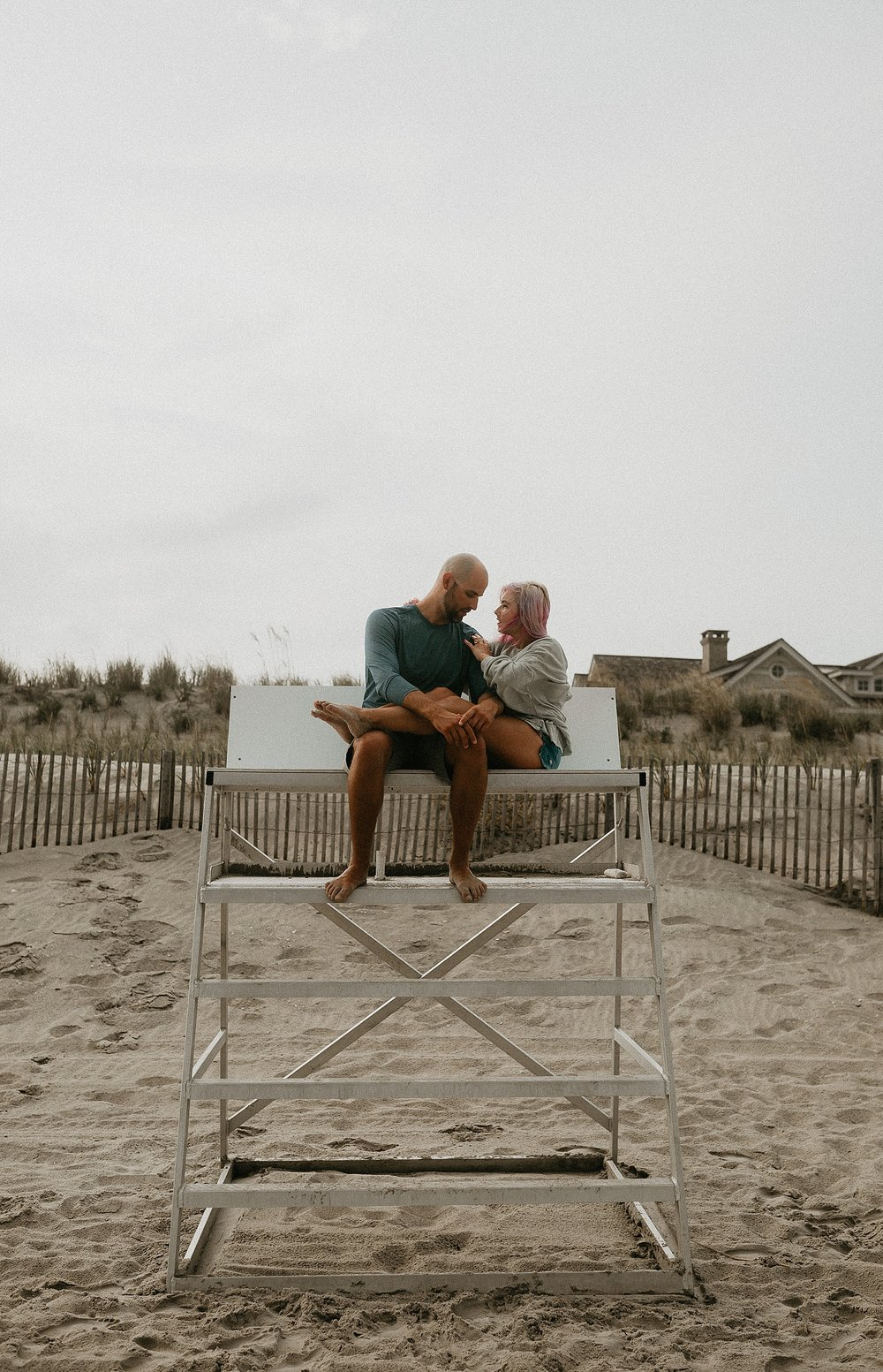 Engagement photo on lifeguard stand in Stone Harbor beach New Jersey