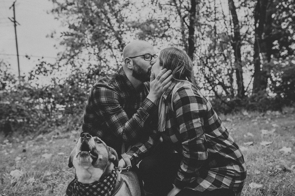 husband and wife kissing at 1181 creekside manor