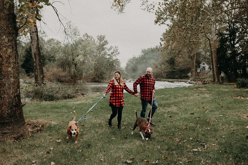 family walk with dogs during portrait session at 1181 creekside manor