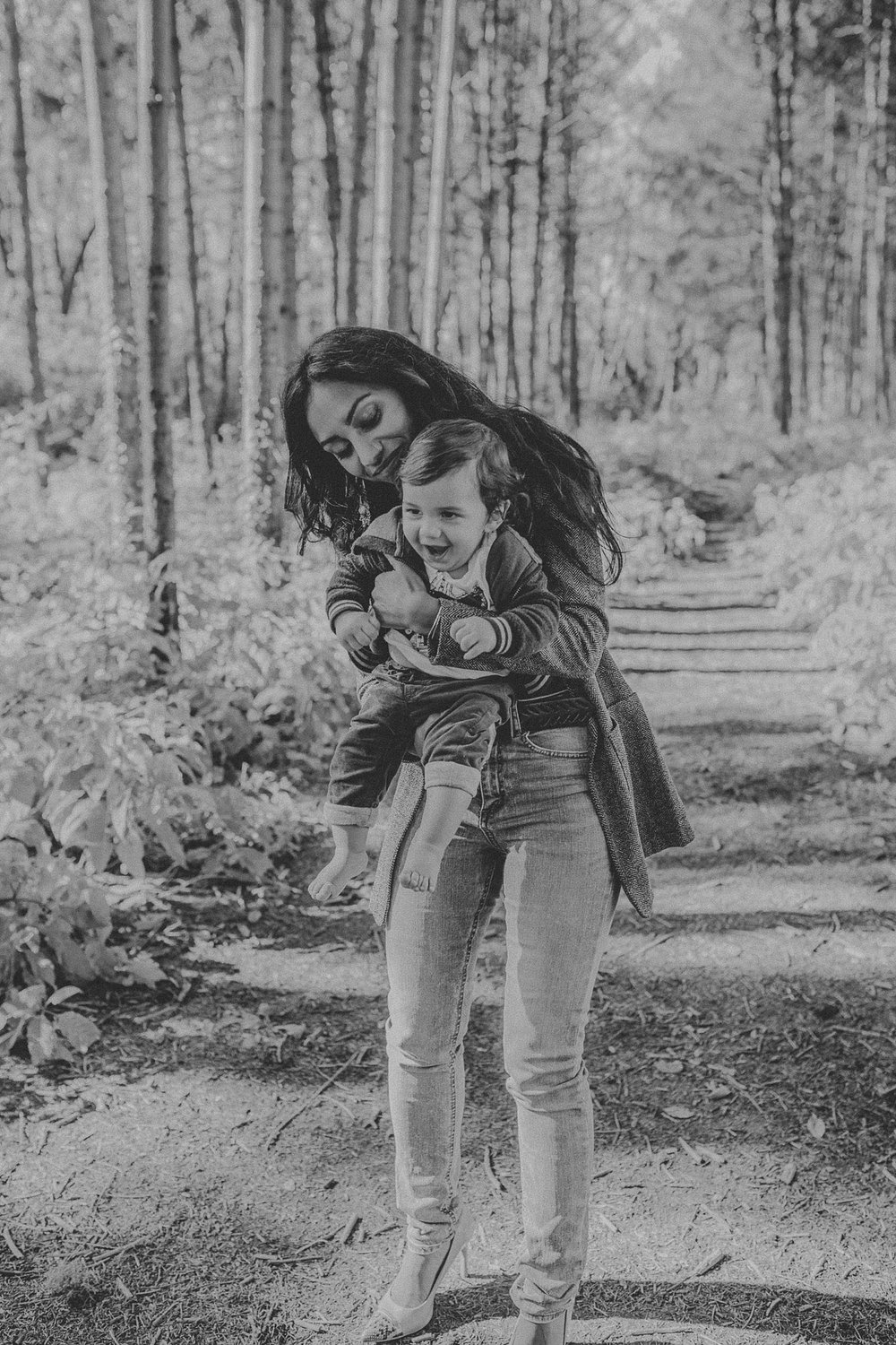 Mother and son laughing and cuddling together during family photos at Overlook Community Park in Lancaster, PA