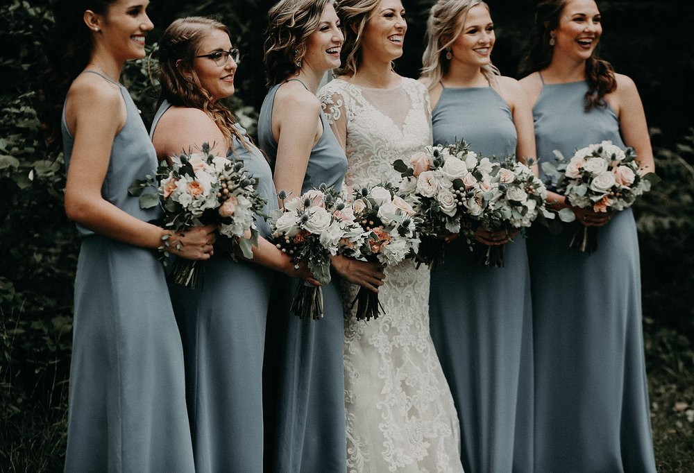 Bride and Bridesmaids holding bouquet during photos on wedding day in Lancaster, PA