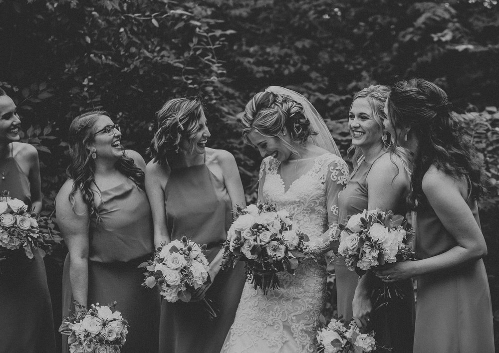 Bridal Party laughing and smiling together on wedding day in Lancaster, PA