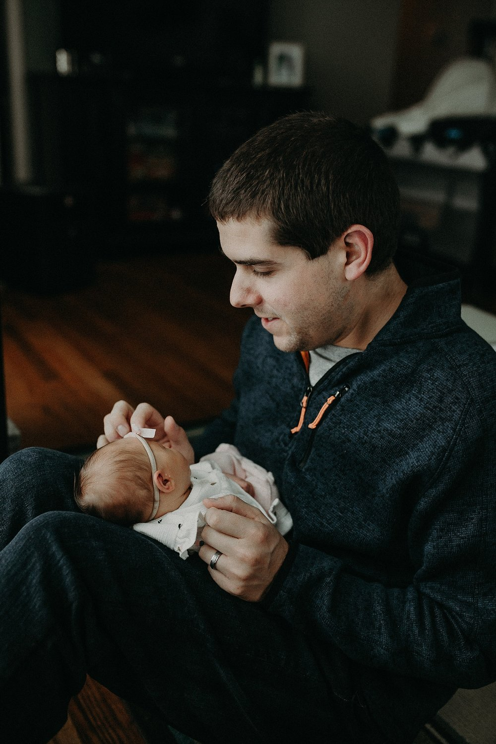 Father and daughter playing together during in home newborn lifestyle photo session in Lancaster, PA