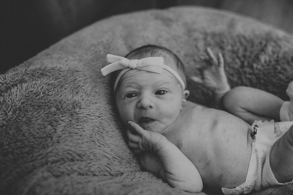 Newborn baby is wide eyed and awake during newborn lifestyle photoshoot in Lancaster, PA
