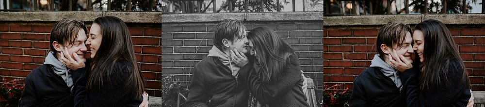 Couple kissing and cuddling sitting on a bench in Greenwich in New York City, New York