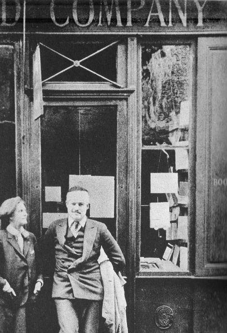 Sylvia Beach and Hemingway in front of Shakespeare and Company