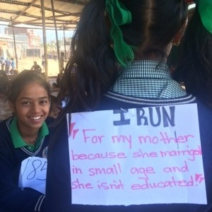 Scholars raise awareness on the back of every 5K participant