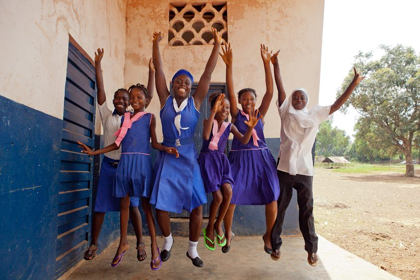 Future STF Scholars in Sierra Leone, jumping outside their classroom. Photo by Kate Lord