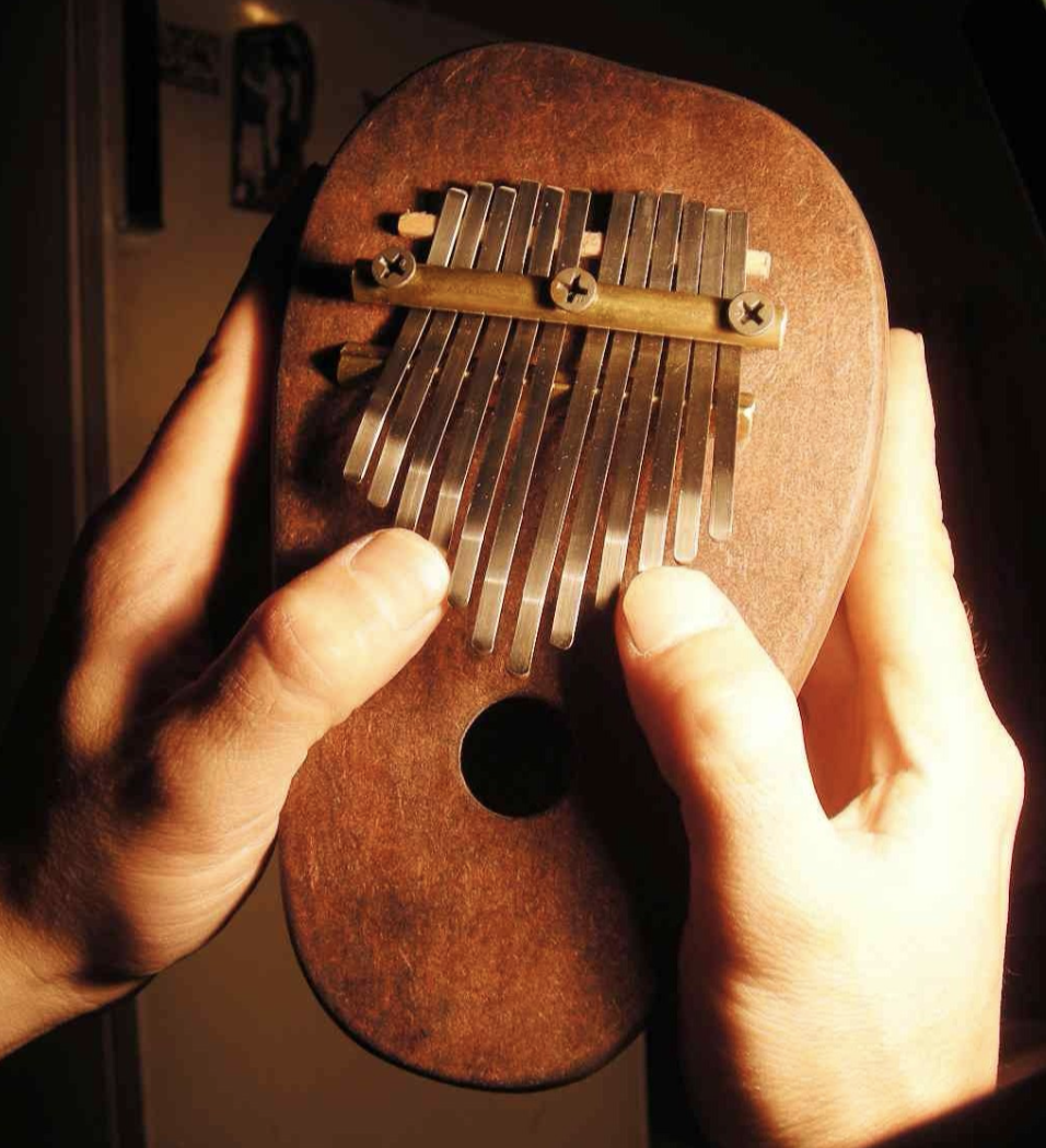 Kalimba - The Kalimba (also known as the Mbira or the 'thumb piano') is a traditional African instrument belonging to the lamellophone family. Lamellophones ('lamella'- Latin for 'plate', 'phone'- Greek for 'sound') consist of a wooden board and metal tines, which are played by hand. There are over a hundred types or lamellophones, each with their own tuning, note layout and name, which vary across the African cultures. The oldest Kalimbas date back as far as 3000 years and are believed to have been invented as a portable xylophone for early Africans. These beautiful instruments are played in different ways across the African cultures. One of the most notable Kalimba traditions belongs to the Shona people of Zimbabwe, who believe that God gave them the Kalimba (referred to as the 'Mbira' by the Shona people) to connect with their ancestors. It is said that the sound attracts the spirits of the deceased, and so the instrument is played in ceremony to reconnect with ancestors and loved ones.