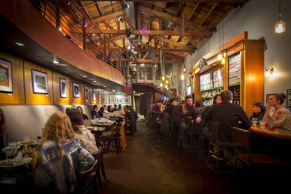 High ceilings and a semi-private mezzanine create a spacious yet intimate ambiance at Social. The on-site brewery located at the very back of the building, overlooks the entire venue.