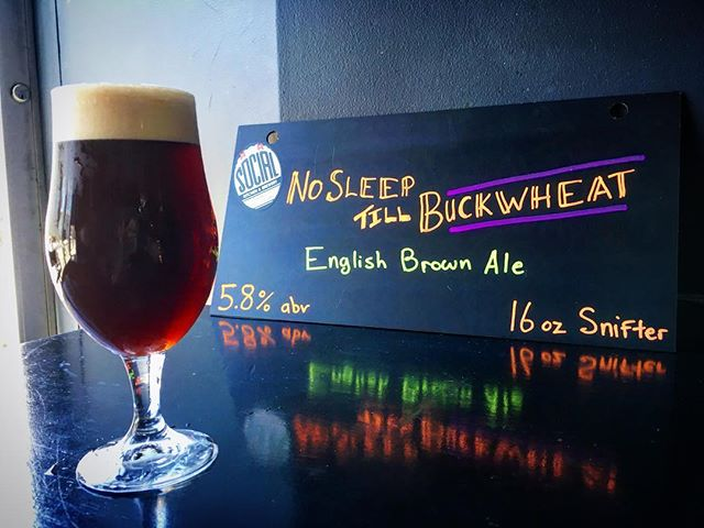 No Sleep Till Buckwheat is our twist on a traditional English brown ale. Brewed with UK grown hops, English specialty malts, and a touch of toasted buckwheat. A winning trio that sends your taste buds straight across the pond 🇬🇧. Smooth malty goodness with flavors of peanut butter cups, light roast coffee, soba noodles and toffee!