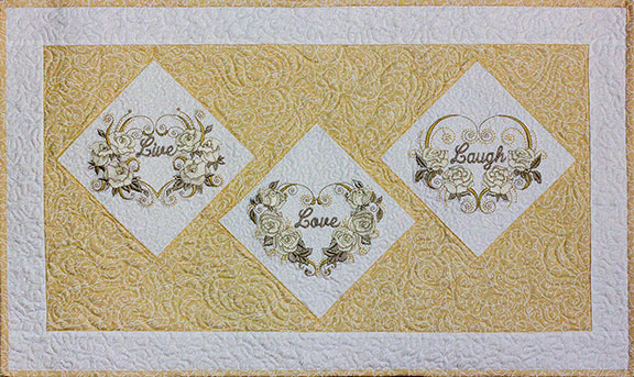 Live Love Laugh Pattern - PDF Pattern for banner featuring Mylar Hearts and Roses embroidery design collection from Purely Gates. This pattern will work with most any embroidery design collection. Finished size is 8.5