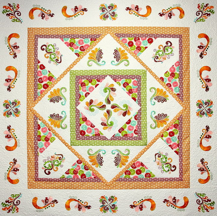 Festive Flourish Quilt Pattern - Pattern for quilt featuring Mylar Festive Flourish embroidery design collection from Purely Gates. This pattern will work with most any embroidery design collection. Finished size is 58