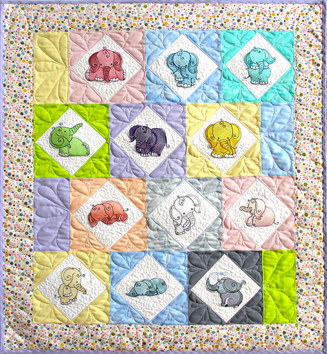 Staggered Elephant Baby Quilt Pattern - PDF Pattern for quilt featuring Mylar Curly Elephants embroidery design collection from Purely Gates. This pattern will work with most any embroidery design collection. Finished size is 32